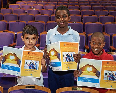 students hold study guide books at the broward center